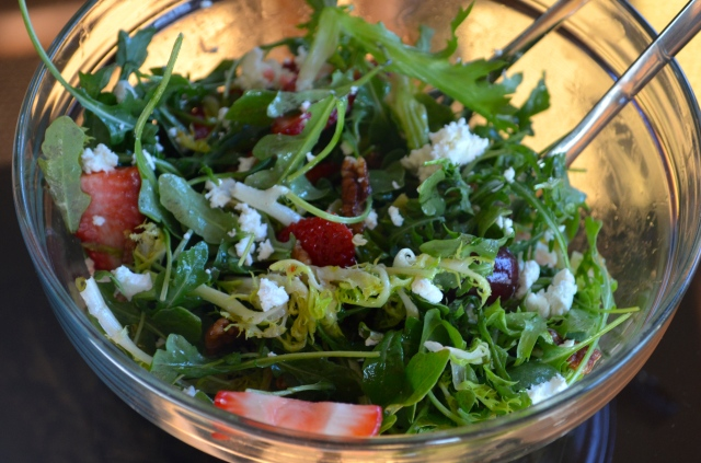 Frisee Salad with Arugula in a glass bowl